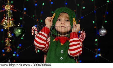 Little Blonde Kid Teen Teenager Girl In Christmas Elf Santa Helper Costume Posing Isolated On Black