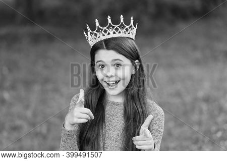 Prom Accessory For You. Prom Girl Pointing Fingers Green Grass. Happy Child Wear Prom Crown. Prom Pa