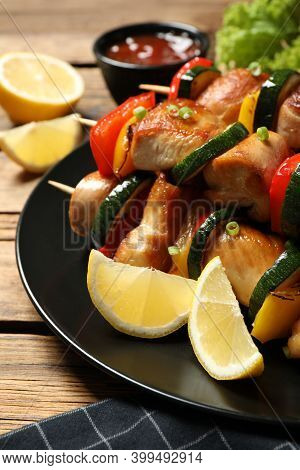 Delicious Chicken Shish Kebabs With Vegetables And Lemon On Wooden Table, Closeup