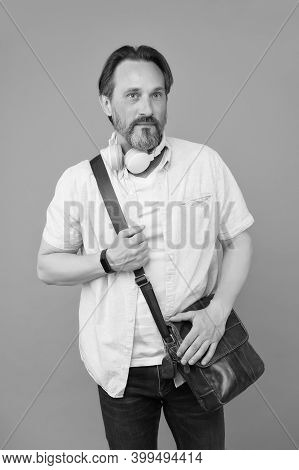 Casual Looks Gorgeous On Him. Bearded Man Listen To Music In Casual Style. Mature Man Wear Casual Cl