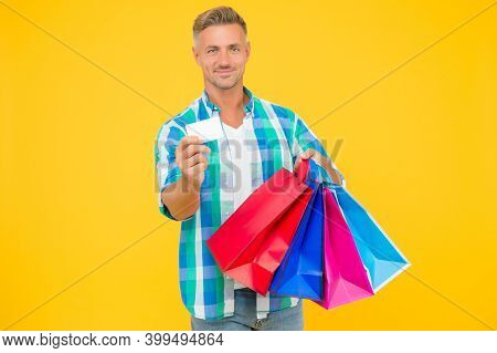 Cyber Monday In Shop. Payment Method. Successful Male Shopping. Handsome Man With Paperbags Show Bus