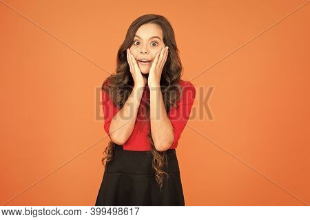 Surprise For Her. Surprised Girl Brown Background. Little Child With Facial Expression Of Surprise.