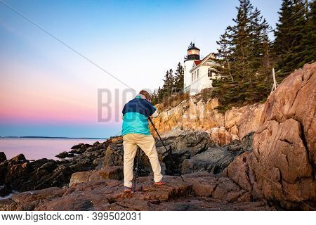 Photographer Taking Shoot At Bass Harbor Lighthouse In Maine, Acadia