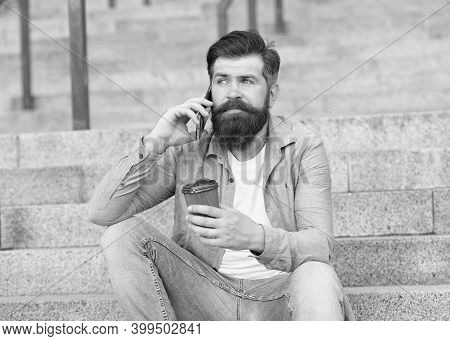 Modern Urban Life. Bearded Man Phone Conversation. Mobile Conversation. Coffee Break. Personal Commu