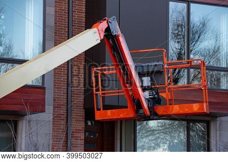 Red Hydraulic Utility Lift Used In The Construction Industry Mobile Heavy Crane