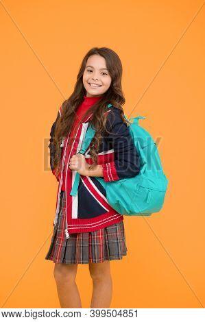 English Style Fashion. Small Girl Uniform Hold Backpack. Kid With English Flag On Jacket. Go Study T