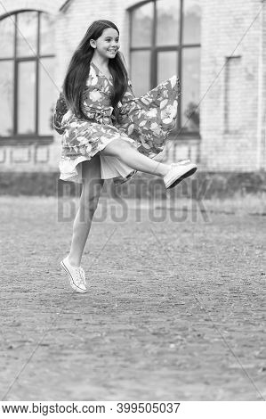 I Am Free. Happy Girl Jump Up Outdoors. Energetic Child In Suumer Dress. Free To Move. Summer Vacati