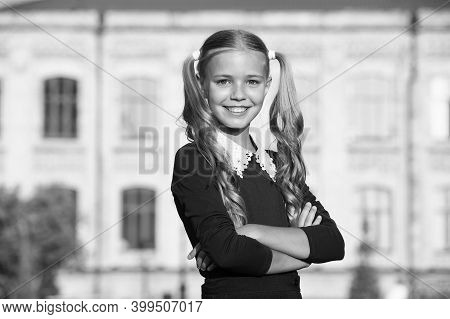 Visit Your Salon Regularly. Happy Child Wear School Uniform Outdoors. Little Girl With Long Blonde H