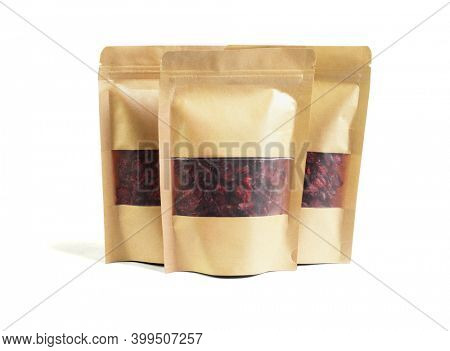 Dried Cranberries in Paper Packs on White Background