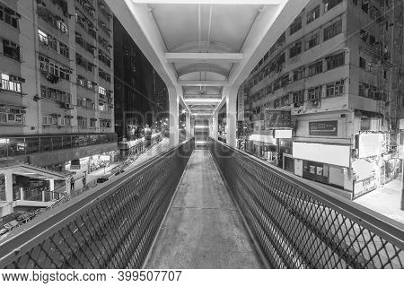 Hong Kong, China - February 27, 2019 : Empty Narrow Footbridge In Midtown Of Hong Kong City At Night