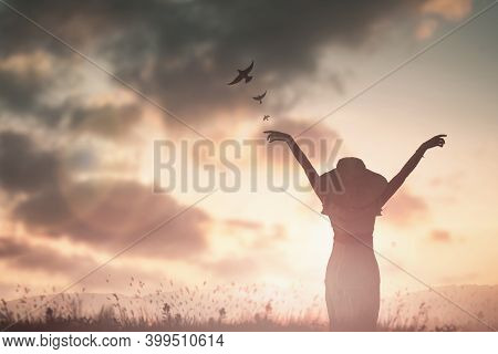 Silhouette Woman With Hands Rise Up On Beautiful View. Christian Praise On Hill Thanksgiving Day Bac