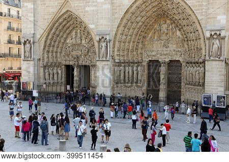 Paris, France - June 07, 2013: People In Front Of The Entrance To Notre Dame Cathedral.