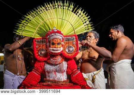Payyanur, India - December 5, 2019: Theyyam artist preparing to perform during temple festival in Payyanur, Kerala, India. Theyyam is a popular ritual form of worship in Kerala, India