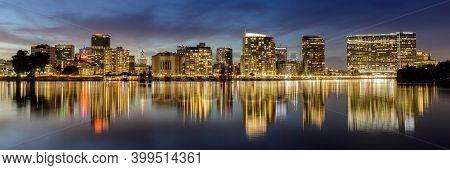 Oakland, California - December 14, 2020: Dusk Reflections Of Downtown Oakland Via Lake Merritt