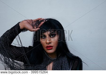 Portrait Of Transgender Latina Wearing An Exotic Drag Queen Costume. Transsexual