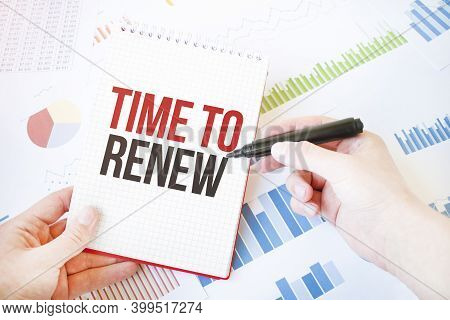 Notepad With Text Time To Renew. Diagram And White Background