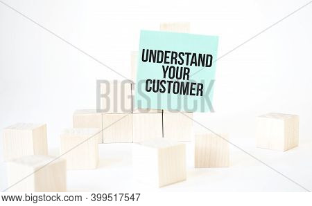 Text Understand Your Customer Writing In Green Card Cube Ladder. White Background. Business Concept