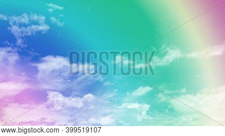 Upward Skyscape View, Rainbow Bright Color On White Fluffy Clouds And Vivid Blue Sky