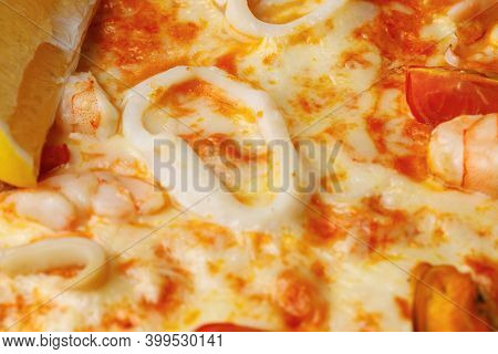 Close Up Of Seafood Pizza With Calamari Rings And Cheese