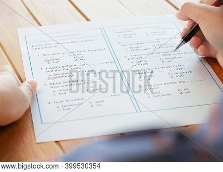 English Grammar Sheet On Wooden Table For Test