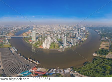 Aerial Top View Of Curve Of Chao Phraya River And Bangkok Downtown. Thailand. Financial District And