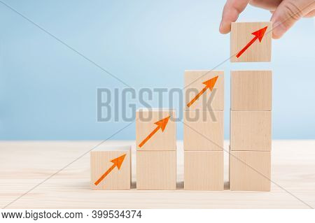 Business Concept Of Ladder Career Path And Growth Success Process. Hand Of Men Arranging Wood Cube B