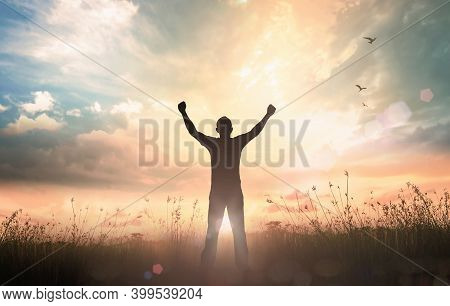Wellness Recovery Action Plan (wrap) Concept: Silhouette Of Man Raised Hands At Autumn Sunset Meadow