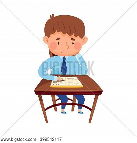 Clever Boy Sitting At Desk At School Lesson And Reading Copy-book Vector Illustration