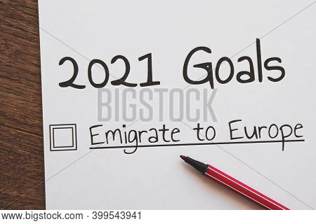 Planner Of Goals And Plans For 2021, A Sheet Of Paper With The Inscription Emigrate To Europe From T