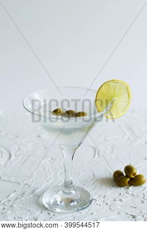 Martini With Lemon And Olives. Martini Glass With Cocktail And Olives On White Background. Cocktail