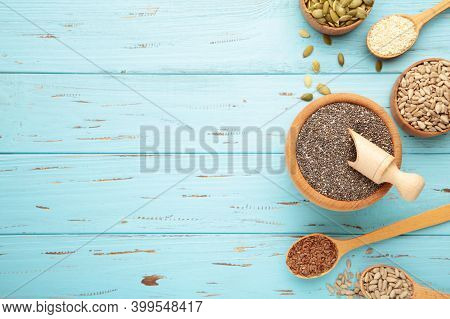 Healthy Superfood: Sesame, Pumpkin Seeds, Sunflower Seeds, Flax Seeds And Chia On Blue. Top View
