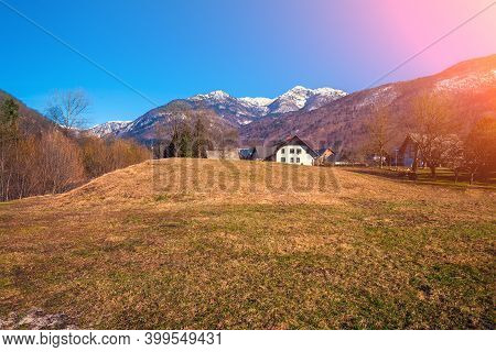 Alpine Landscape In Early Spring On A Sunny Day. Alpine Village. Slovenia, Europe