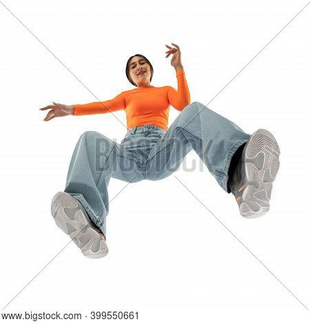 Dancing. Young Stylish Woman In Modern Street Style Outfit Isolated On White Background, Shot From T