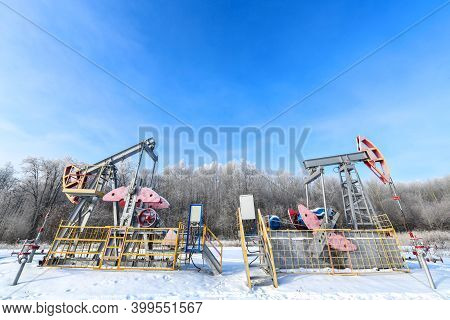 Oil Pumpjack Winter Work Is The Overground Drive For A Reciprocating Piston Pump In An Oil Well. It