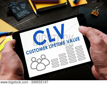 Man Reads A Customer Lifetime Value Clv Report On A Tablet.