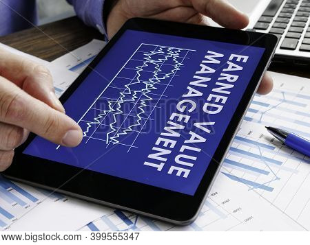 Manager Reads Earned Value Management Evm Report.