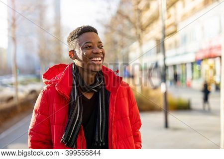 Young black man standing in a city street