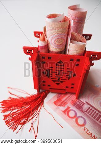 Miniature Chinese Pavilion In Bright Red Standing On And Filled With Chinese 100 Renminbi Banknotes