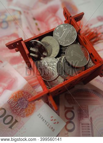 Miniature Chinese Pavilion In Bright Red And Filled With Chinese 1 Yuan Coins, Standing On Chinese 1
