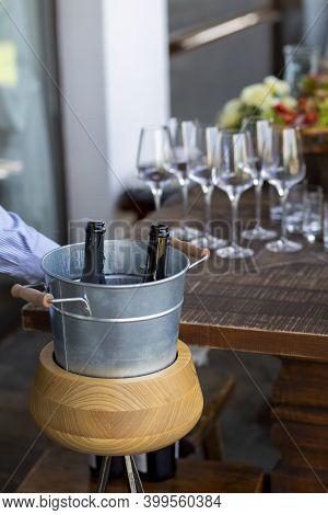 Champagne In An Ice Bucket. A Bottle Of Open Champagne. Gas Comes Out Of The Bottle. Champagne Is Op