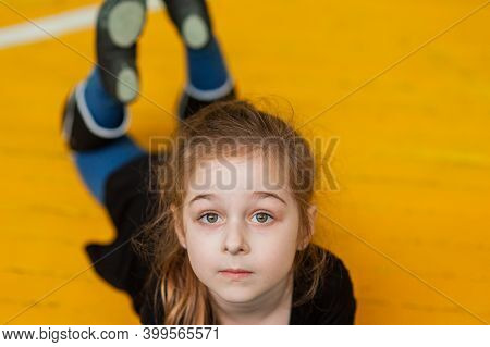 Little Girl Doing Gymnastics. Little Gymnast Girl In Gym. Girl Gymnast In The Gym. Sport.