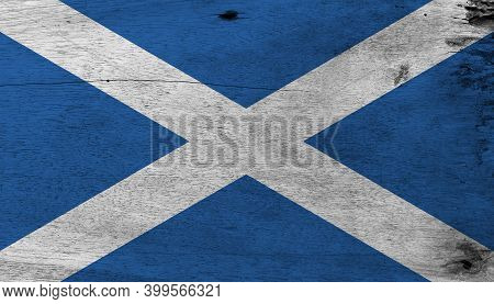 Flag Of Scotland On Wooden Plate Background. Grunge Scotland Flag Texture, It Is A Blue Field With A