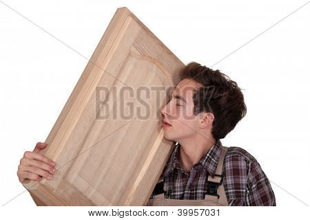 Man nuzzling a hand-crafted piece of wood poster