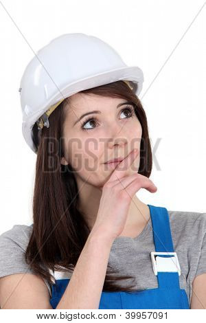 Portrait of a tradeswoman deliberating
