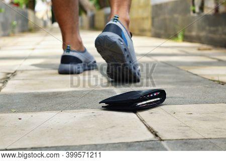 Man Lost Wallet On Street, Wallet Laying At Sidewalk