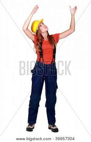 A female construction worker repositioning something.