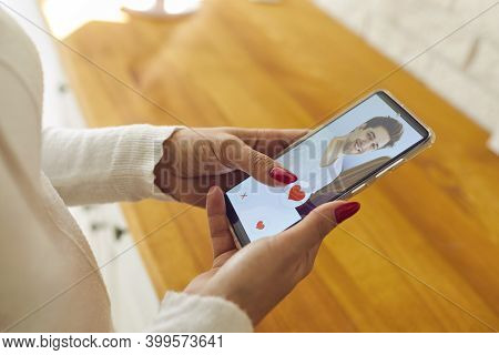 Single Woman Holding Mobile And Giving Like To Mans Profile Picture On Dating App