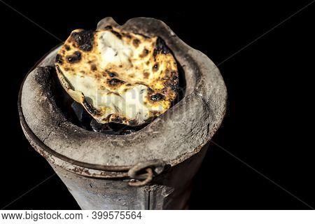 Shot Of Tandoori Roti On Old Style Cooking Sigdi.