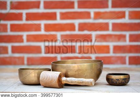 Tibetan Singing Bowls With Sticks On The Wall Background - Music Instruments For Meditation, Relaxat