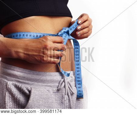 Woman Measuring Waist With Tape On Knot, African Tan Isolated